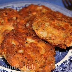 Salmon Patties.1 (14.75 ounce) can of pink or red salmon, drained  1/3 cup of finely minced onion  1/4 teaspoon of freshly cracked black pepper, or to taste  1 tablespoon fresh chopped parsley  1/4 teaspoon of fresh lemon zest  15 crackers, crushed fine  1 large egg, beaten  1/8 cup of water  1/2 cup of canola