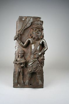 Plaque: Iyase with Sword and Attendant, 1550–1680. Nigeria, Court of Benin. The Metropolitan Museum of Art, New York. The Michael C. Rockefeller Memorial Collection, Gift of Nelson A. Rockefeller, 1972 (1978.412.320) #sword