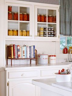 pretty farmhouse kitchen and I love the fabric for the window curtain seeing that it looks just like mine! :) sb
