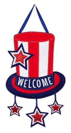 "Welcome"""" is handsomely embroidered on this patriotic themed door hanger. Constructed with thick, sculpted pieces of outdoor safe polyester material that looks and feels like felt and lightly padded f"