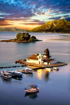 Pontikonisi at sunset, Corfu Island, Greece.  Ancient Byzantine church, the monastery of Pantokrator which can approximately be dated back to the11th or 12th century. www.facebook.com/loveswish