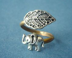 Silver elephant ring with a leaf wrap  Roommate: no idea where to find this, but it's cute :)