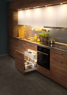 There is no question that designing a new kitchen layout for a large kitchen is much easier than for a small kitchen. A large kitchen provides a designer with adequate space to incorporate many convenient kitchen accessories such as wall ovens, raised. Modern Kitchen Cabinets, Modern Kitchen Design, Interior Design Kitchen, Kitchen Island, Kitchen Backsplash, Interior Ideas, Wooden Kitchen, Interior Design Ideas For Small Spaces, Walnut Kitchen