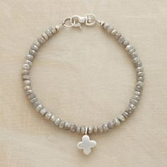 """Subtly sparkling, faceted labradorite beads suspend the simplest sterling cross. Silver lobster clasp. Made in USA exclusively for Sundance. Approx. 7-1/2""""L."""