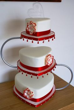 3 tier Red and ivory heart wedding cake with open rose and beaded board