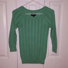 American Eagle sweater American Eagle sweater, three quarter length sleeves with button details, color is sea foam green. Size is xsmall but I would say it fits like a small. American Eagle Outfitters Sweaters