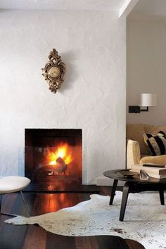 Are you looking for mantel decorating ideas? Having a cohesive look to your mantel decor is key. When decorating your mantle make sure you have a theme, like a common shape, item type, or color scheme. Keep reading as we share 10 ideas for how to decorate your fireplace mantel like a pro. Hadley Court Interior Design Blog by Central Texas Interior Designer, Leslie Hendrix Wood