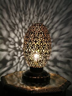 Antique brass egg lamp wired to take a bulb. http://www.maroque.co.uk/showitem.aspx?id=ENT05242&s=20-50-039