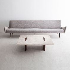 Upholstered three-seat sofa with turned jacaranda legs and coffee table with travertine marble top and veneered jacaranda frame. Designed by Jorge Zalszupin, Brazil, 1960s.
