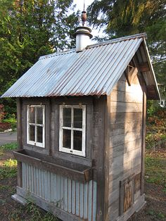 Tiny potting shed using recycled wood and tin....cute!!