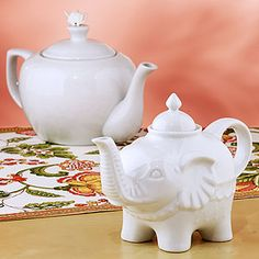 Love this ceramic teapot, and think @Sherry S @ Young House Love would like the baby elephant too.