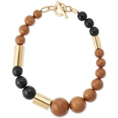 Michael Kors Gold-Tone Wood Bead Colorblock Statement Necklace ($154) ❤ liked on Polyvore featuring jewelry, necklaces, gold, gold tone jewelry, color block necklace, wooden beads jewellery, bead jewellery and beading jewelry
