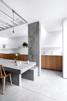 Kitchen with concrete floor and table. Shoot Factory