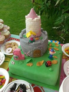 My daughter's 1st birthday cake! Ben and Holly little Kingdom castle.