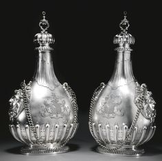 A large pair of George V silver pilgrim flasks, William Comyns & Sons Ltd, London, 1934 | lot | Sotheby's