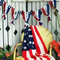 A simple bunting made from strips of fabric is a bright addition to this patriotic porch!
