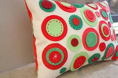 Change up colors to make for different holidays. Felt circles with simple embroidery and sewing stitches.