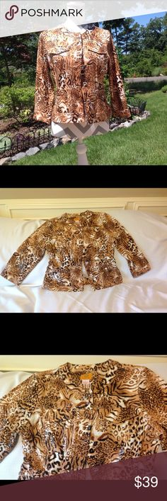 Beautiful animal print, light jacket Very shiny, animal print light jacket. 4 pockets in front. Polyester and spandex. Excellent condition Ruby Rd. Jackets & Coats Blazers