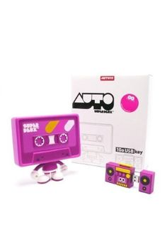 """AUTO EURO (PINK) VERSION Mixtape Vinyl Figure w/ 1GB USB Key by Artoyz. $59.95. Height: approx 5"""". Designer: Superdeux. Medium: Vinyl. Edition: 350. Auto was created back in 2002 for the electronic band Auto and has been widely used on their album covers, posters, apparel and more. It's gone through several proposed toy incarnations before the final version you see here. With the upcoming release as an art toy, Auto's maturation as a character is complete."""