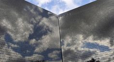 Clouds are reflected on the Vietnam War Memorial during Veterans Day ceremonies on Nov. 11, 2011, in Washington, D.C.