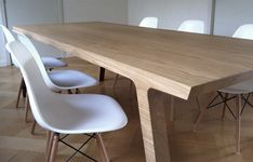 One(by Ronald Knol) One is a designer dining table that unites dueling personalities—it is at once elegant and raw. The long side of the table has a soft silhouette, while the sh