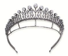 AN ANTIQUE DIAMOND TIARA / NECKLACE c1890.  Designed as a series of graduated diamond collets on knife-edge bars to the diamond-set trefoil spacers, mounted in silver and gold, with diamond collet backchain. (photo Christie's)