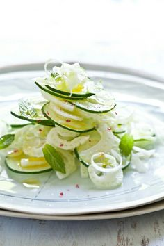 Fennel and Cucumber Salad Ingredients: 4 scallions 1 seedless cucumber 1 fennel bulb 1/3 cup fresh mint leaves one lemon oil and vinegar to taste salt and pepper to taste Instructions: Cut the scallions lengthwise, keeping all of the white parts and most of the green. Place in a bowl of ice water (it will make those lovely scallion curls) while you prepare the rest of the ingredients. Slice the cucumber and fennel into thin slices using a mandolin or a sharp knife. When ready to plate, layer…