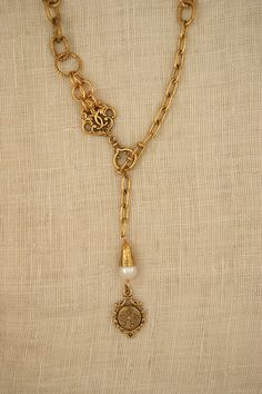 Necklace with vintage watch fob and freshwater pearl by ExVoto Vintage Jewelry.