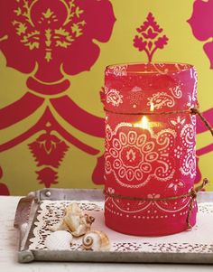 Candle Cover - A stiff, slightly sheer bandanna works best here. Cut the fabric to match the hurricane cover's height, then wrap around the glass. Cut to fit or overlap excess fabric, folding under the edges for a neat seam. Secure with two pieces of knotted twine.