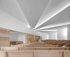 Beautiful indirect light inside the Nossa Senhora das Necessidades Church  by Célia Faria + Inês Cortesão.