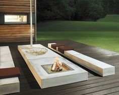 Amazing sleek fireplace fire pit in this outdoor living space. Looks like a great place to have some company and great times.