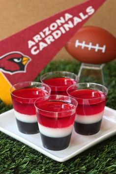 Arizona Cardinals Jell-O Shot (3 oz. box cherry Jell-O 4 envelopes Knox plain gelatin 3 cup vodka 1 cup milk 1/4 cup granulated sugar 3 1/2 Tbs grape Jell-O powder 3 1/2 Tbs lime Jell-O powder Black food coloring)