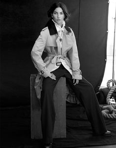 Photographed in black and white, Lily Aldridge wears Burberry trench coat, ruffled top and pants