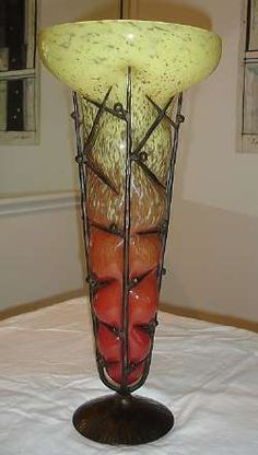 ANTIQUE SIGNED SCHNEIDER FRENCH ART GLASS VASE WITH IRON MOUNT CIRCA 1920S. The glass body is mottled red-orange