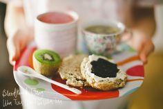 Apple-cinnamon scone w cream cheese and blueberry jam, kiwi, raspberry/banana smoothie, tea