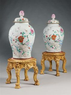 A MAGNIFICENT PAIR OF FAMILLE ROSE CHINESE PORCELAIN VASES