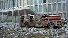 FDNY fire truck outside the north tower before it collapses.