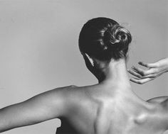 from the back a beautiful black and white photo.  love the lines of her fingers and hand while she tilts her head to show off her neck which we all know is very alluring to our guy friends and husbands!