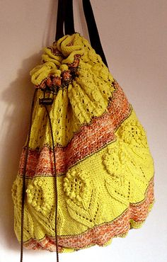 Free Knitting Pattern for A Day in the Park Backpack - Drawstring backpack tote with bobble flowers and lace. Designed by Karen Fournier. Pictured project byCardabelle