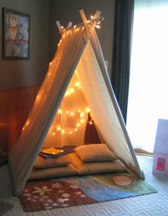Playroom canvas reading tent | 10 Super Snuggly Reading Nooks Part 3 - Tinyme Blog