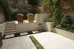 view across contemporary garden with planted Rill, Copper water