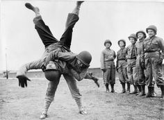 Women in the United States Forces in Britain: Hundreds of United States nurses underwent a toughening up course in preparation for the opening of the second front, where their job would be to follow the troops of liberation and establish hospital units. Lieutenant Louise Erman throwing her Ju-Jitsu instructor Major Strom during an unarmed combat class.