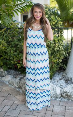 This maxi is definitely worth the wait! It's sure to be a best seller, so don't hesitate to snag yours! It features jagged chevron print in navy, peach, mint, and white, has criss cross straps in the back!