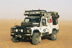 Fully working/kitted Defender. Gerry cans on side for easy access and more room on top.