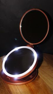 Let Me Review That For You!  LED Lighted Magnifying (1x & 5x) Trifold Small Makeup Mirror by iLuminate  Small mirror with LED lights. Batteries required but provided...  http://www.letmereviewthatforyou.com/2016/07/led-3fold-by-iluminate.html  Disclosure: I received this item in exchange for my sincere, impartial testing, and assessment. My opinion is always based on mine, and my family's experiences with the product. I have no relationship with the seller, and there were no promises re