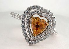 "What a gorgeous ring!!  A Fancy Orange Heart Shape Diamond set in the center of a Heart Shaped ""Double Halo"" of high quality diamonds.    BloomingBeautyRing.com  (213) 222-8868"