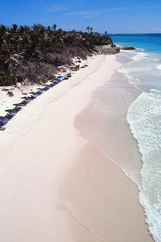 Crane Beach is famous around the world for its array of beach colors from blue to turquoise and aquamarines. The water near the beach is calm, since it is protected by a natural coral reef.