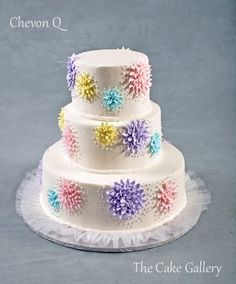 Wedding Cake Photos | The Cake Gallery Omaha. Pastel multi colored dahlia looking flowers on white, so pretty!