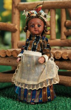 German Brown-Complexioned All-Bisque Doll by Simon and Halbig in Antique Costume.