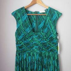 Calvin Klein patterned dress New with tags! Lovely colors for Spring and Summer! Length shoulder down approx 37.5 inches. Armpit to armpit measures16 inches. 95% poly 5% spandex. Calvin Klein Dresses